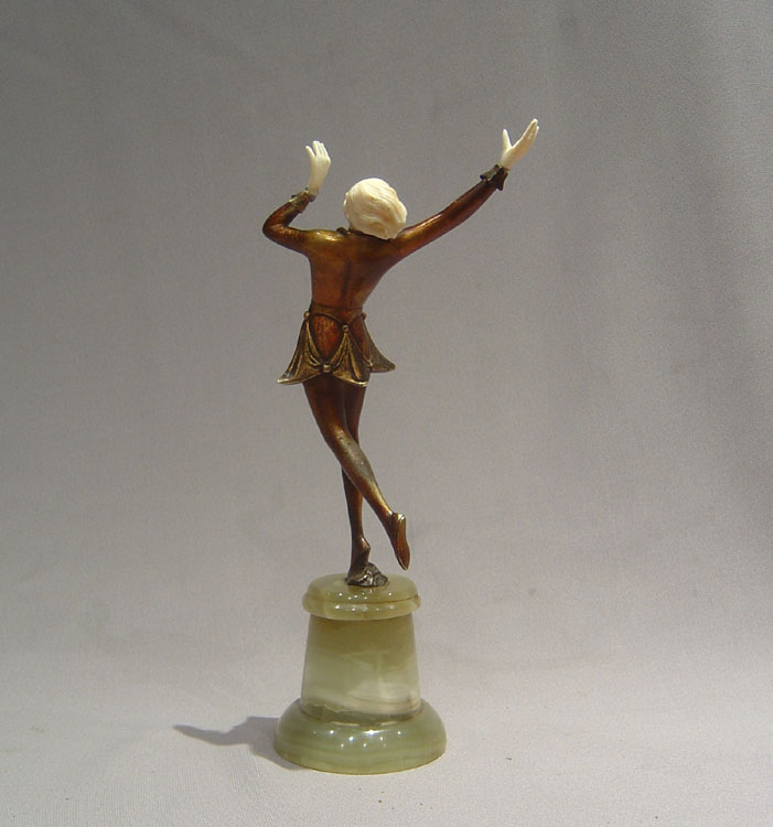 A fine and honest bronze and ivory figure of a girl dancing.