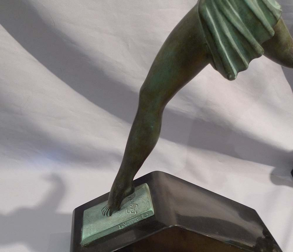 Art Deco green patinated bronze  of a dancer on a marble base.