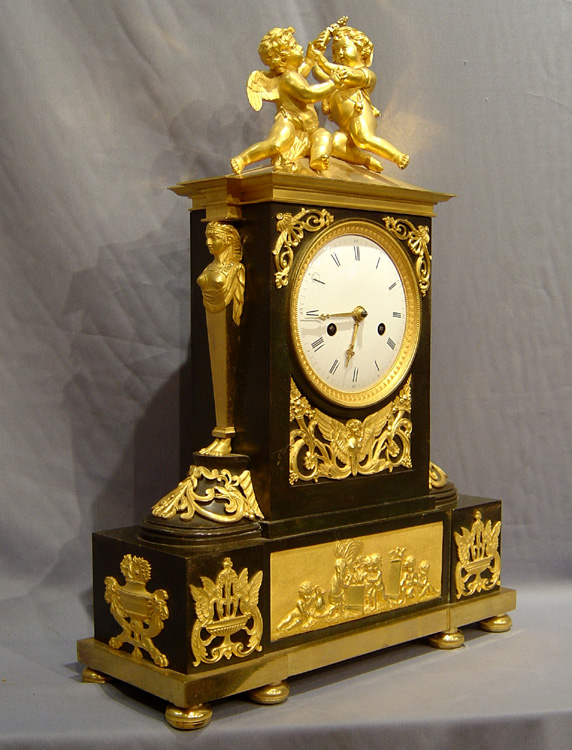 Antique French Directoire ormolu and patinated bronze clock with Egyptian theme.