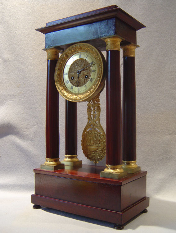 French Charles X period antique mahogany and gilt bronze mounted portico clock