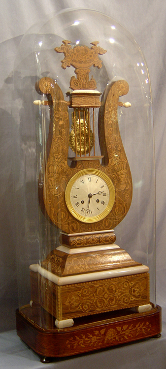 Antique French Louis Philippe Lyre clock in rosewood and marquetry under original glass dome.