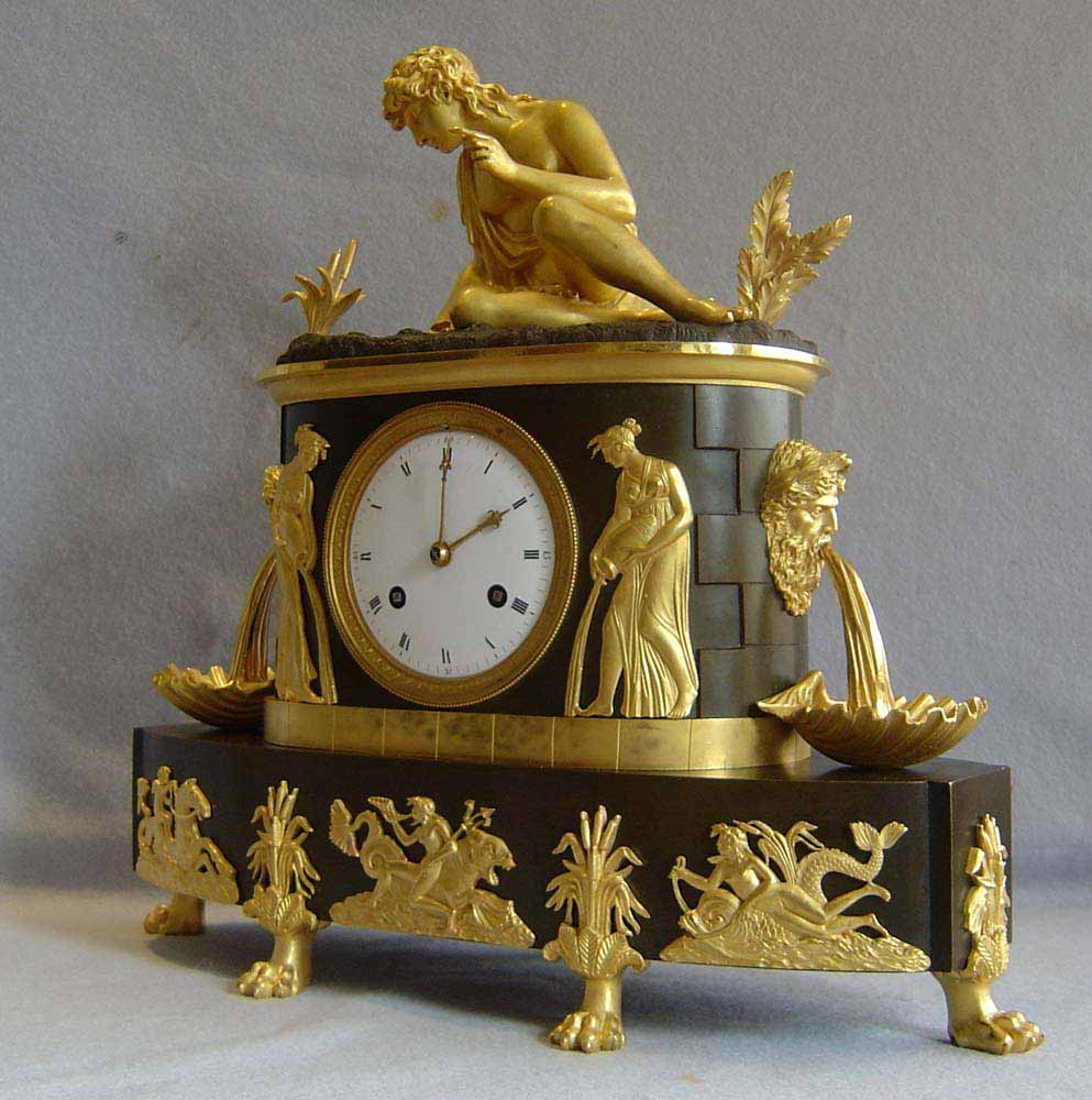 French antique clock. Empire period of Narcissus dated 1808.