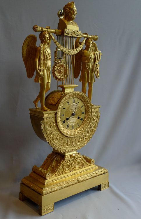 Antique French Empire ormolu clock with reversed pendulum, two standing figures, probably by Thomire