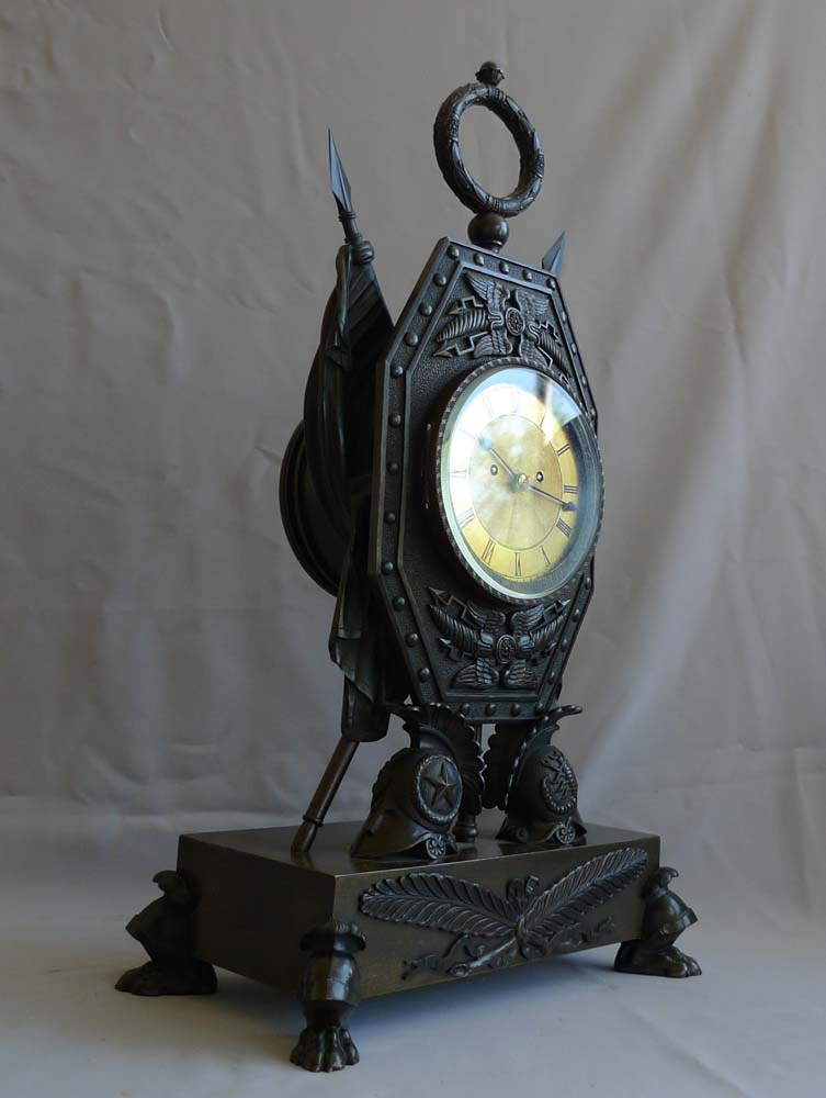 Antique clock in form of Trophies of War English Regency by Forrester of Hull.