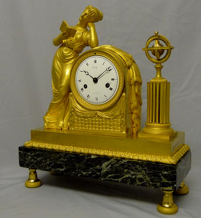 French Empire mantel clock in ormolu and marble vert designed by Reiche of astronomy.
