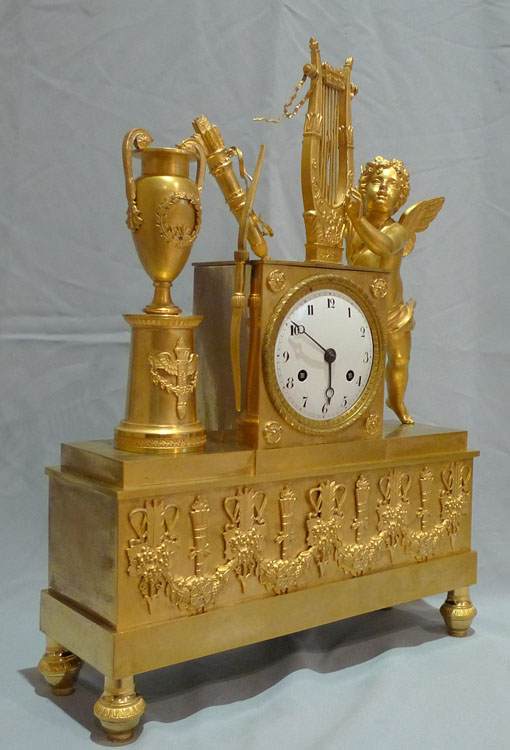 Antique French Empire clock in gilt bronze with Cupid.