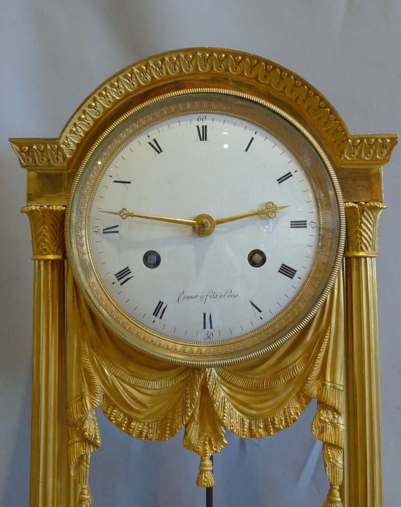 Antique French Directoire ormolu mantel clock signed Coeur et Fils a Paris and dated 1804.