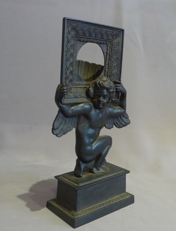 Antique Russian cast iron neo classical watchstand of cupid.