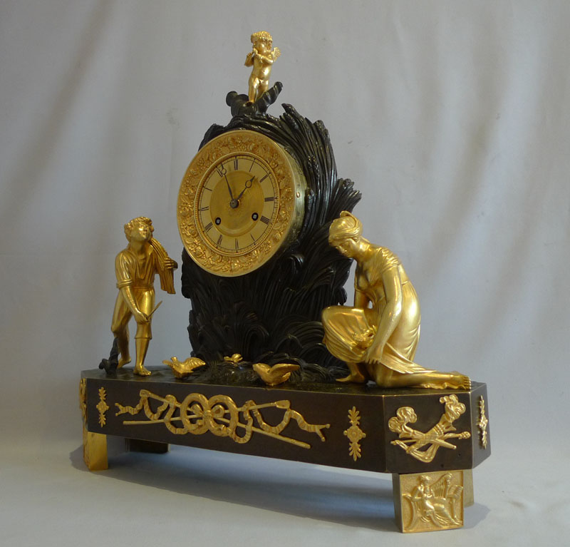 Antique French Charles X ormolu and patinated bronze Arcadian genre mantel clock.