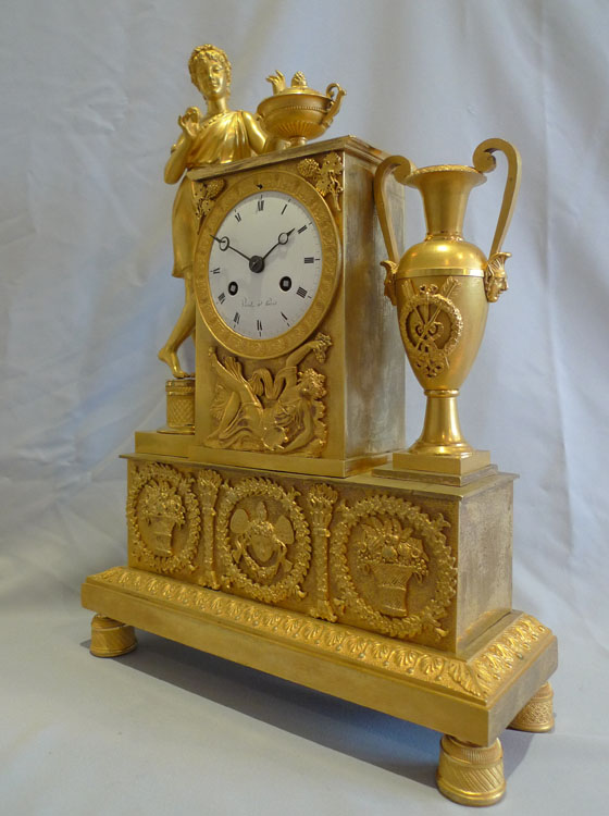 Antique ormolu French Empire clock celebrating viticulture with Cupid and signed Viret a Paris.