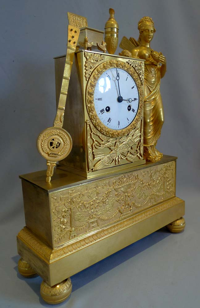 Antique French Empire ormolu clock of a Nike