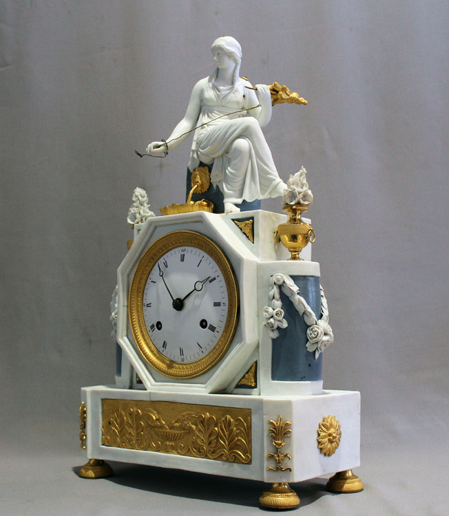 Antique French Directoire period bisque and ormolu mantel clock depicting Ariadne.