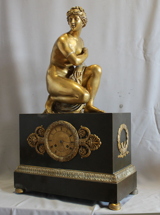 French Charles X mantel clock with Grand Tour Crouching Venus, patinated bronze and ormolu.