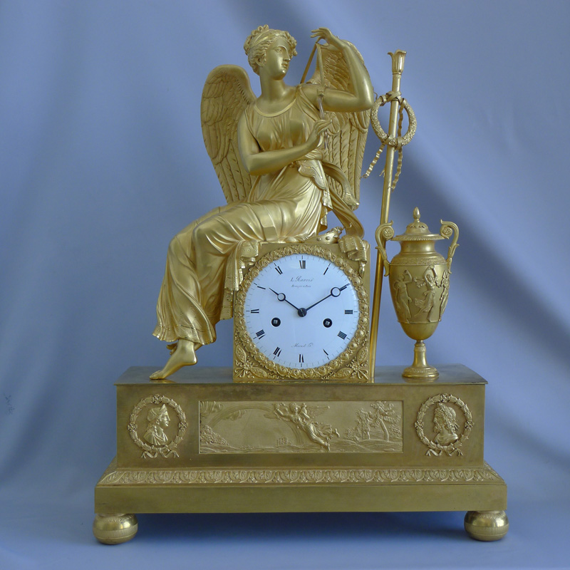 Large antique French Empire ormolu clock of winged goddess signed Ravrio and Mesnil.