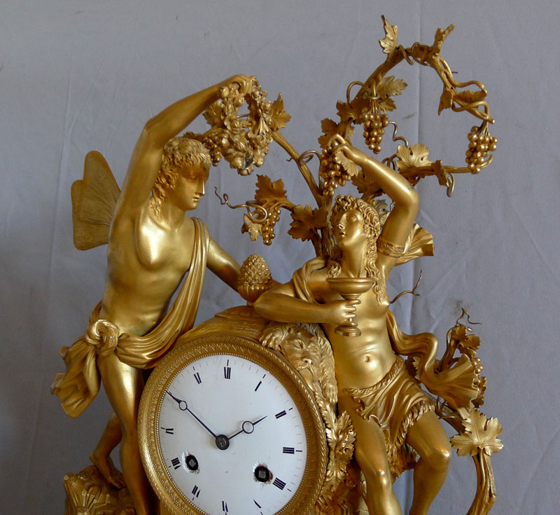 Important antique French Empire ormolu and marble mantle clock of Zephyr and Erigone.