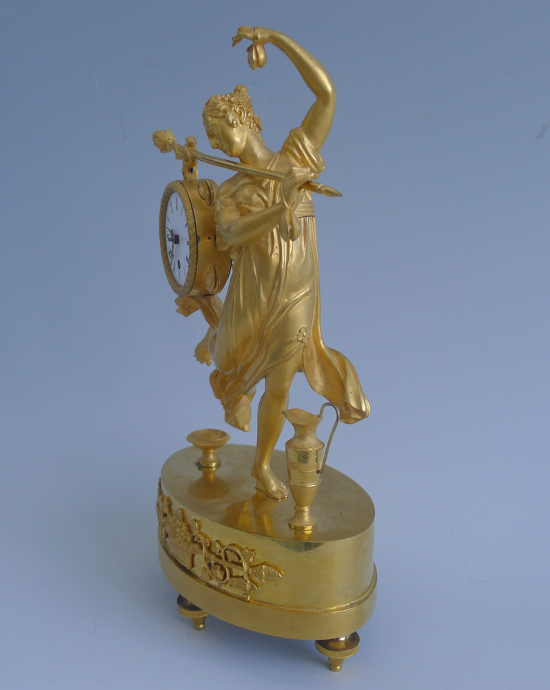 Antique French Empire miniature mantel clock of a dancing bacchante in ormolu