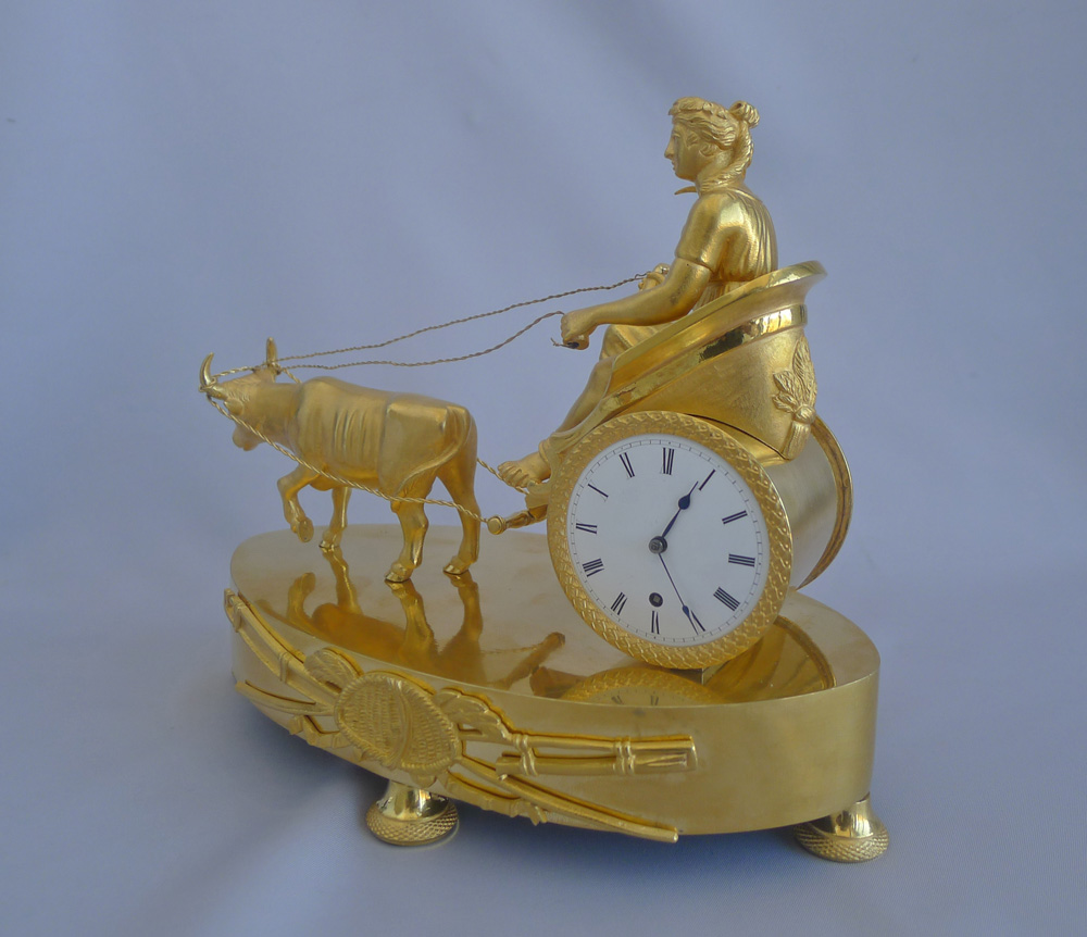 Antique French Empire ormolu mantel clock depicting Ceres on a chariot pulled by a bull