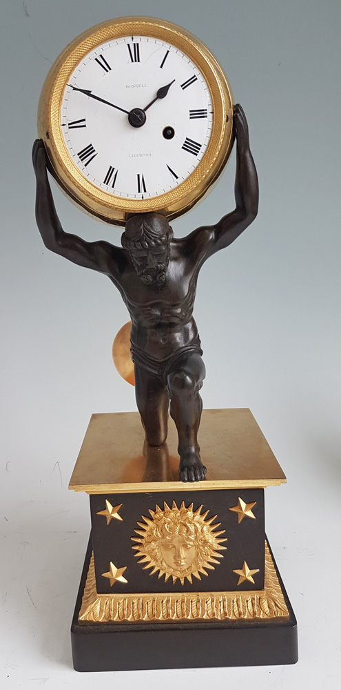 English Regency Ormolu and Patinated bronze mantel clock of Atlas holding the world by Roskell