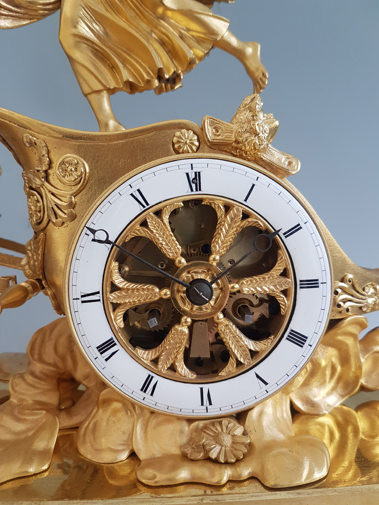 French Empire antique Ormolu mantel clock of Aurora in her Chariot pulled by her winged horses