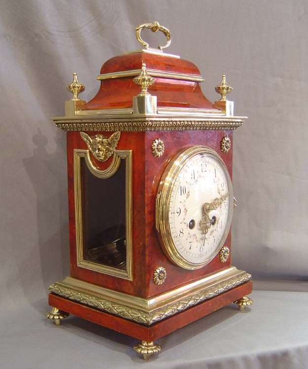 Antique French scarlet stained tortoiseshell and gilt bronze mantel clock