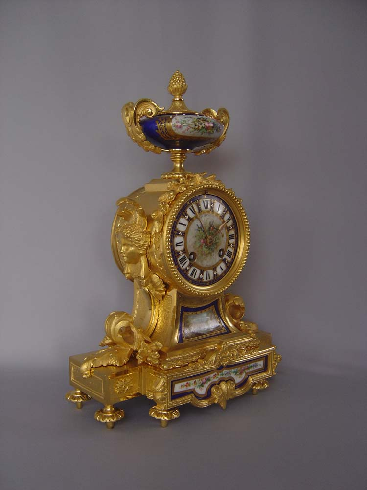 French antique ormolu and bleu du roi jewelled porcelain clock.