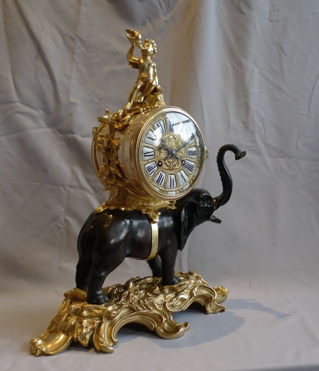 Antique Elephant clock in patinated and gilt bronze.