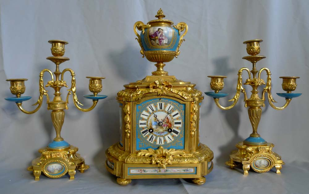 Antique French clock set in ormolu and blue celeste porcelain.