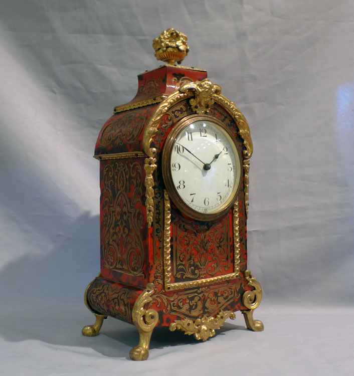 Antique French boulle ( tortoiseshell and brass) mantel clock in Louis XIVth style.