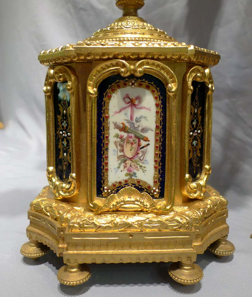 Antique French porcelain and ormolu clock set with fine matching candelabra.