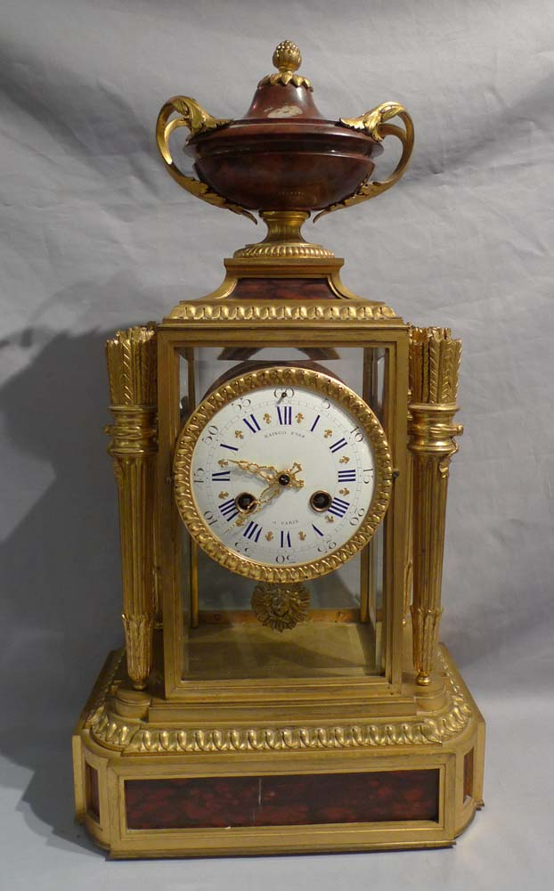 Antique French rouge marble and ormolu four glass clock signed