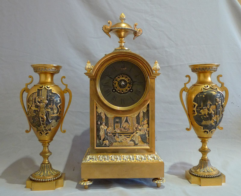 Antique French gilt and silvered bronze clock set with unusual panels.