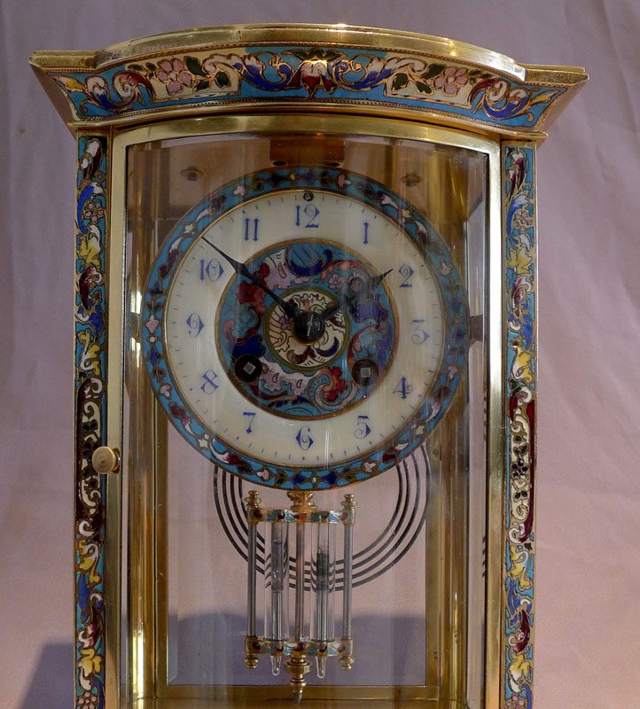 Antique French four glass mantel clock with champleve enamel decoration.