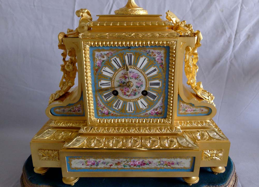 Antique French Napoleon III porcelain, ormolu and silvered bronze clock set.