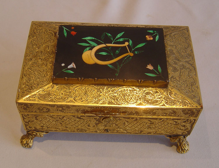 Fine music box in engraved gilt bronze with pietra dura plaque, four tunes.