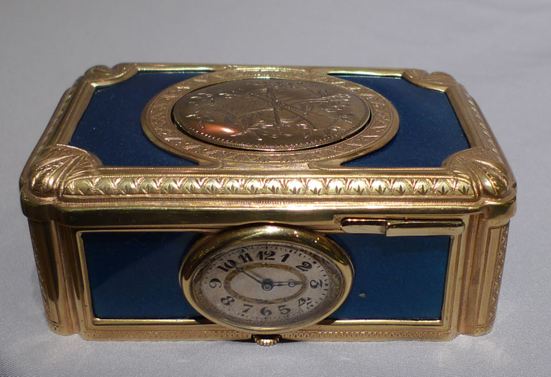 Swiss Rymys singing bird box with watch to front dated 1923.