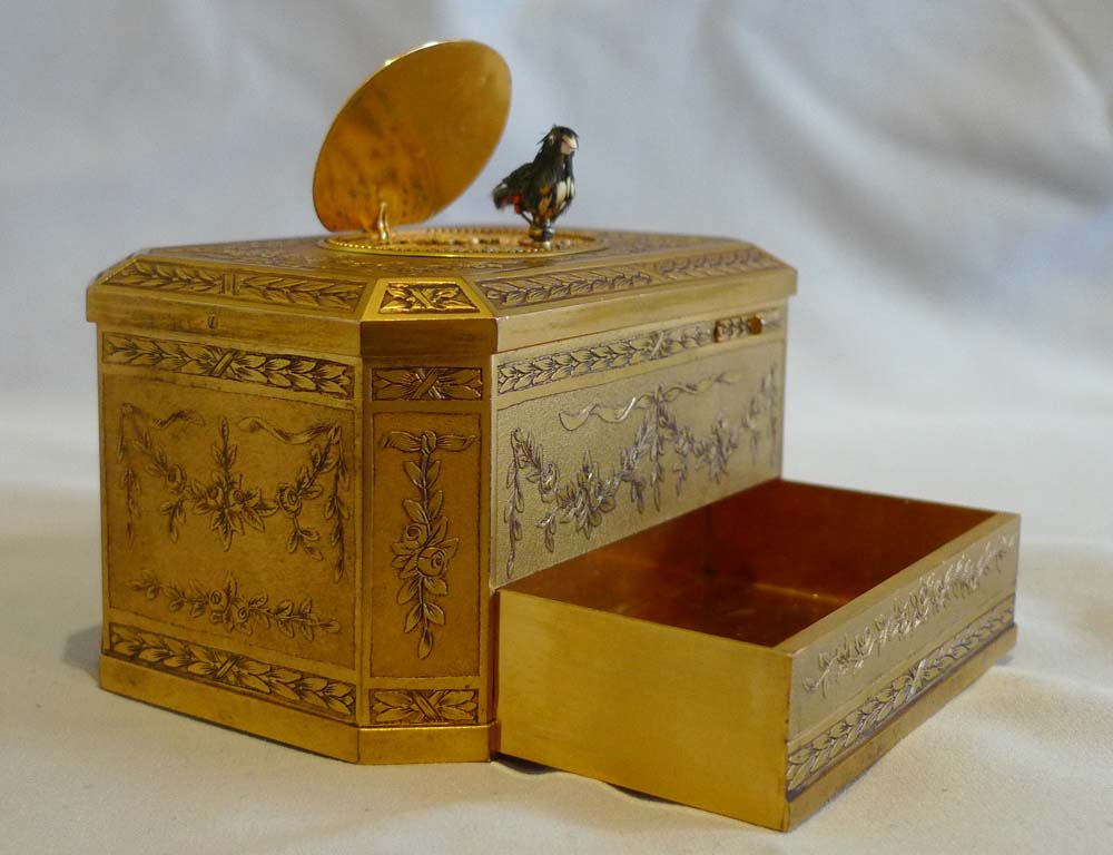Antique singing bird box finely engraved with mechanically opening drawer, Bontems France.