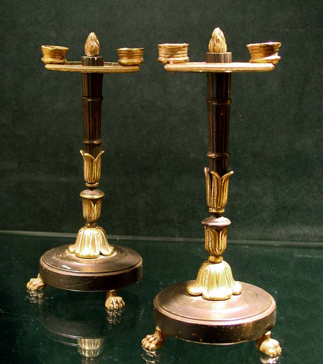Antique pair of French Empire patinated bronze and ormolu candlesticks.