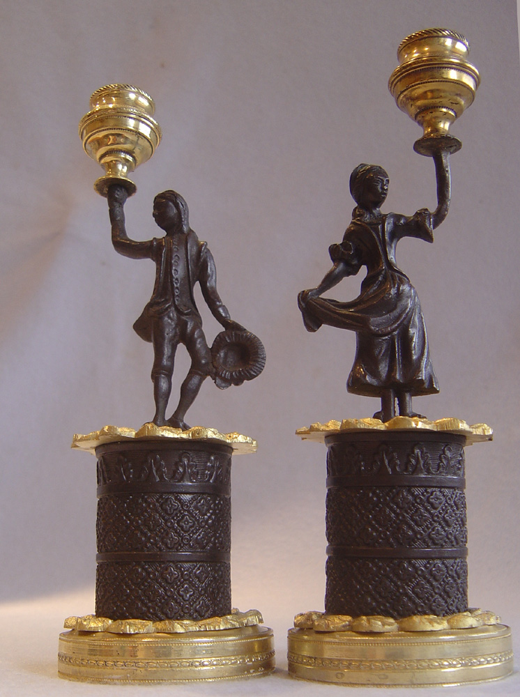 Pair of English Regency figural candlesticks.