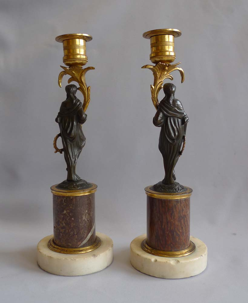 Pair English late 18th century marble, ormolu and patinated bronze figural candlesticks.