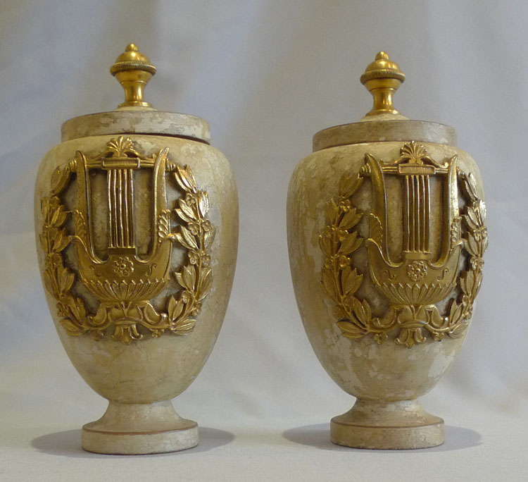 Antique pair of turned and painted covered urns with fine ormolu mounts