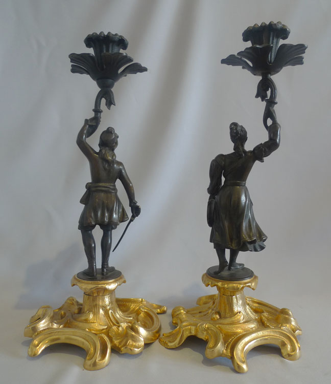 Antique pair Greek Revolution Hellenistic figural candlesticks with figure of hero.