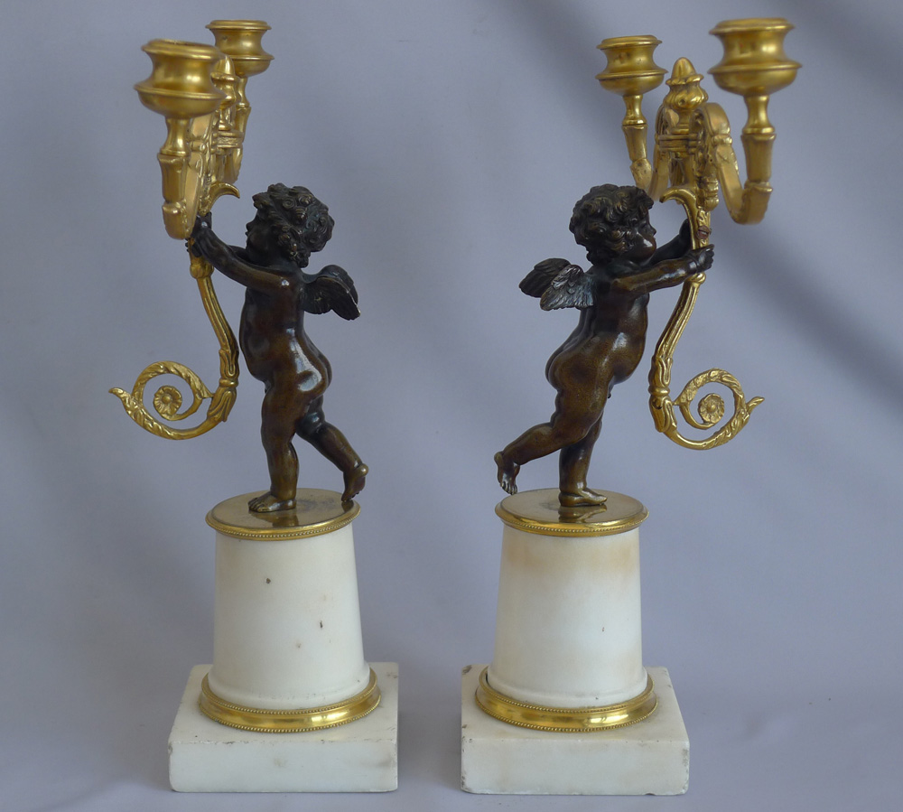 Pair Antique English Regency figural candlesticks in carrera marble, ormolu and patinated bronze