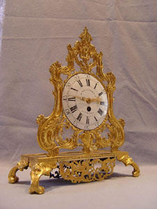 Antique French Louis XV transitional ormolu clock by Conrard a Liege circa 1750.