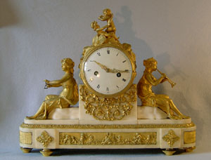 Antique French Louis XVIth mantel clock in ormolu and statuary white marble