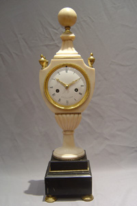 French Directoire period antique urn shaped mantel clock signed Cleret a Orleans.