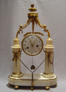 Louis XVIth white marble and ormolu mantel clock.