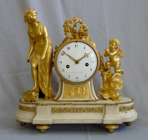 Antique French Louis XVI white marblle and ormolu mantel clock