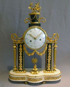 Antique French Louis XVI ormolu mounted white and grey marble mantel clock.