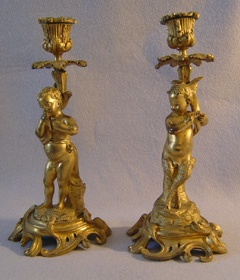 Pair of antique French ormolu figural candlesticks.
