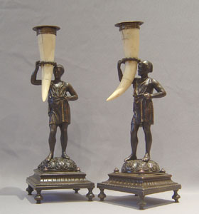 Antique blackamoor or negro candlesticks.